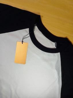 Tag price on black white raglan t-shirt