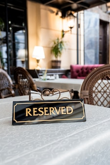 Tag of reservation placed on table