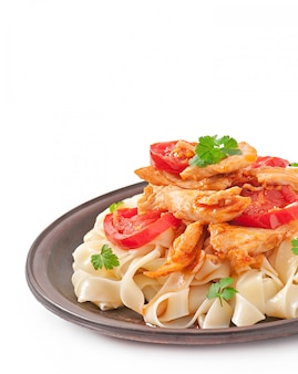 Tagliatelle pasta with tomatoes and chicken