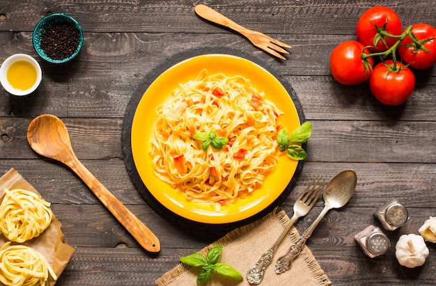 Tagliatelle with tomato and basil, made at home