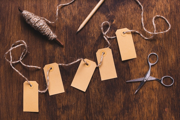 Tags with string and scissors