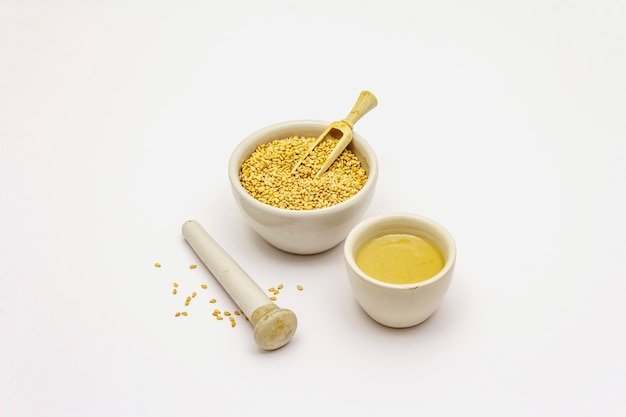 Tahini with sesame seeds isolated