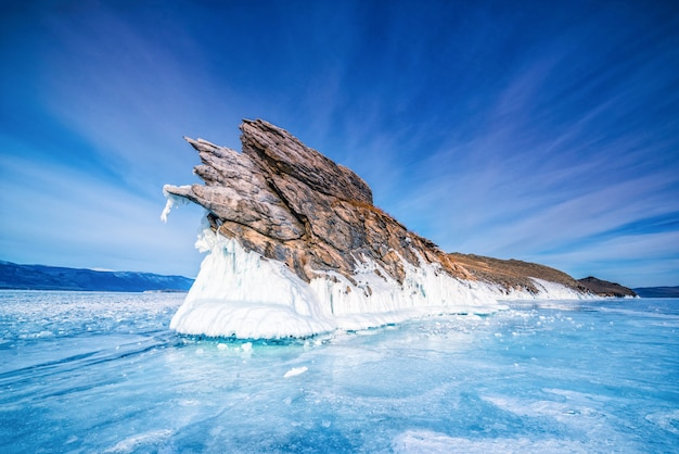 Tail of ogoi island with natural breaking ice in frozen water at lake baikal, siberia, russia.