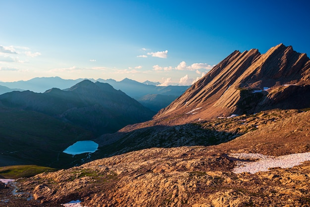 Taillante ridge in the french alps at sunset, idyllic mountain landscape rocky terrain and alpine lake at high altitude