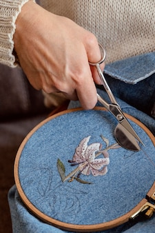 Tailor creating a beautiful decoration