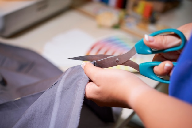 Tailor cutting fabric for dress
