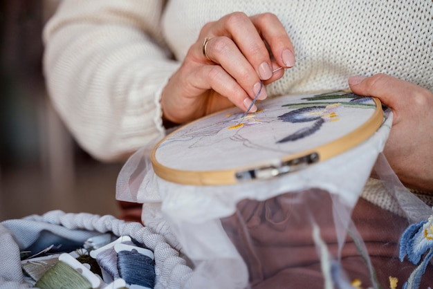 Tailor making a home decoration close-up