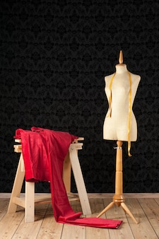Tailor mannequin with tape measure