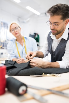 Tailor sewing jacket