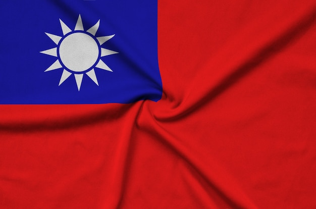 Taiwan flag  is depicted on a sports cloth fabric with many folds.