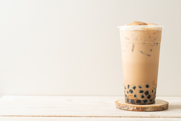 Taiwan milk tea with bubble and cheese burned on wood table