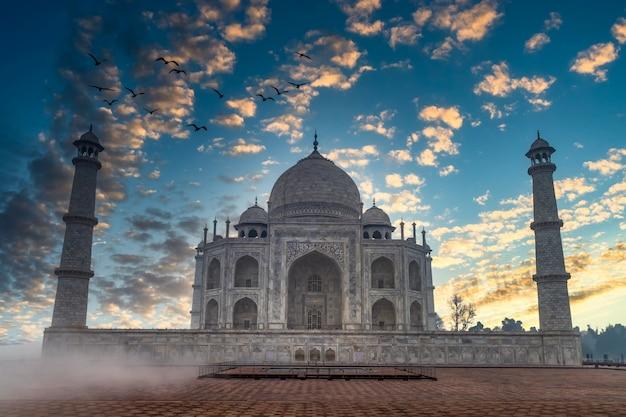 The taj mahal mausoleum at sunset