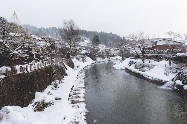 Takayama city with miyagawa river in winter