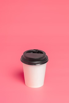 Take away coffee cup on colorful paper background