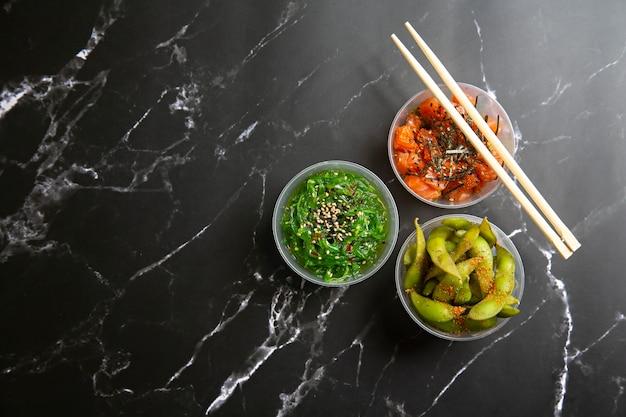 Take away poke food on black marble surface