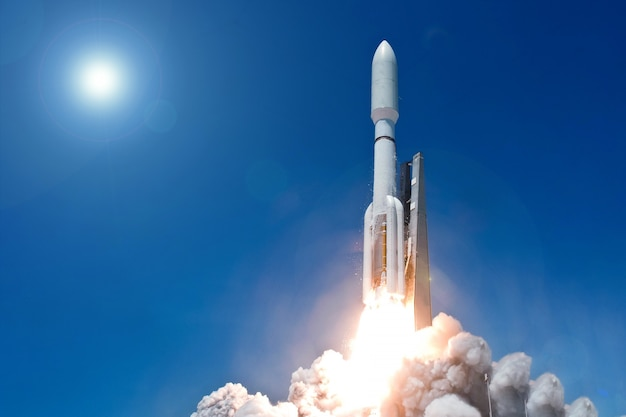 Take off space rocket on a background of blue sky and sun elements of this image furnished by nasa