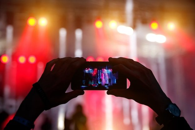 Take a picture on concert, smartphone record.