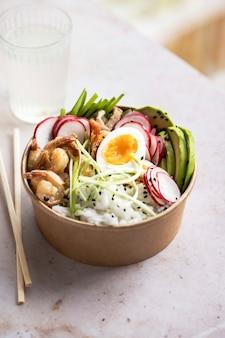 Takeaway egg and prawn poke bowl