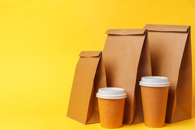 Takeaway food concept. some packed food in container with coffee cup on table