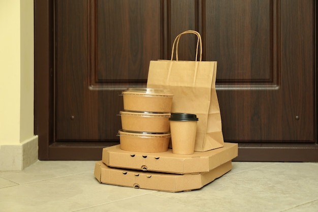 Takeaway food containers on the floor near the door