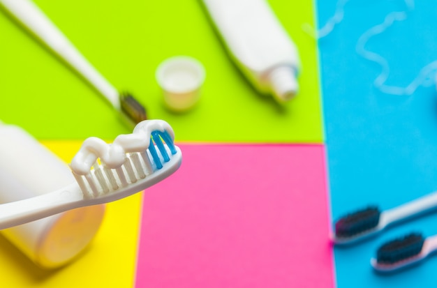 Taking care of teeth, dental concept on color