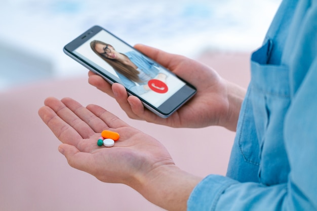 Taking medication and pills for the treatment of diseases and well-being. consultation with a doctor online.