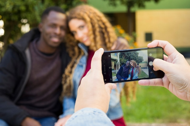 Taking photo of afro american couple