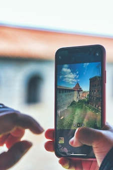 Taking a photo on a smartphone while traveling fortress oreshek