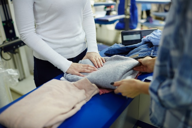 Taking pullover from dry cleaning