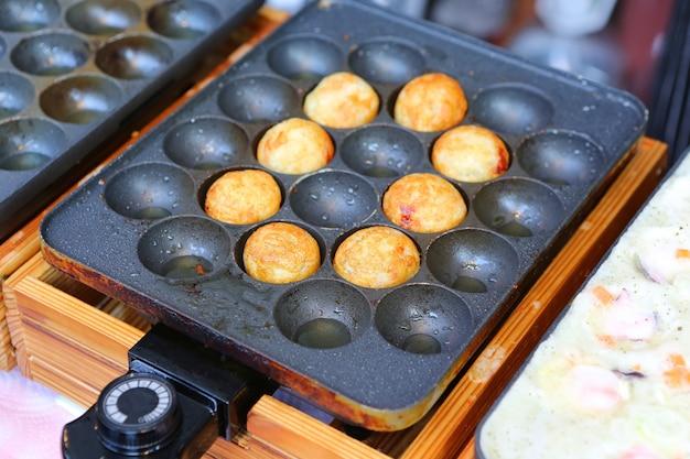 Takoyaki octopus balls on pan