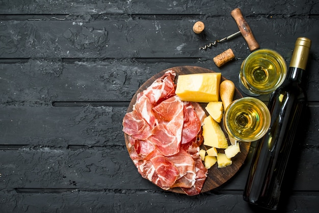 Talian appetizers with white wine.