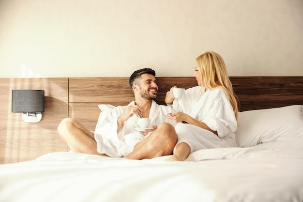 Talking in bed, a morning gossip party with your loved one over a cup of hot beverage, coffee or tea