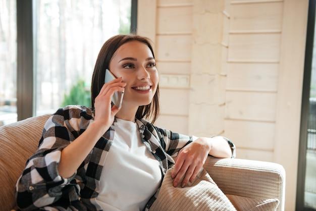 Talking on phone in living room