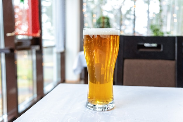 Tall glass of beer on a pub's table