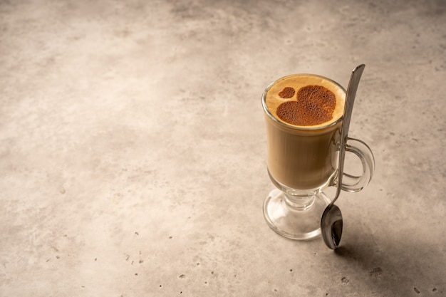 Tall glass, latte, cappuccino, coffee, cafe, cafe menu, drawing in the shape of a heart