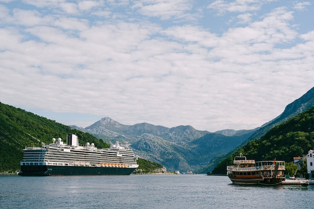 A tall, high-rise huge cruise liner in the verige strait, in the boko kotor bay in montenegro