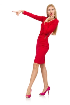 Tall young woman in red dress isolated on white