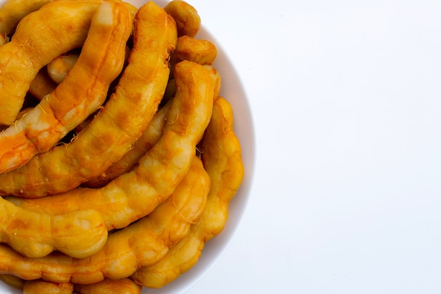 Tamarind pickled fermented on white background.