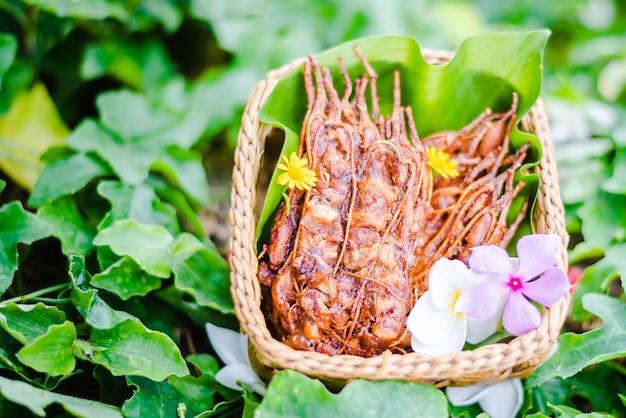 Tamarind pulp taken on bamboo basket