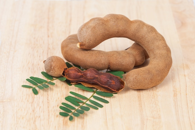 Tamarind - sweet ripe tamarind with isolated on a white background. soft focus