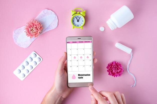 Tampon, feminine, sanitary pads for critical days, feminine calendar. care of hygiene during menstruation. tracking the menstrual cycle and ovulation.