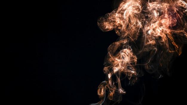 Tan smoke on black background