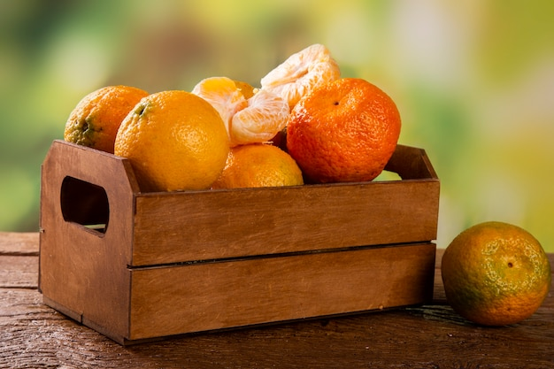 Tangerine box on wooden table
