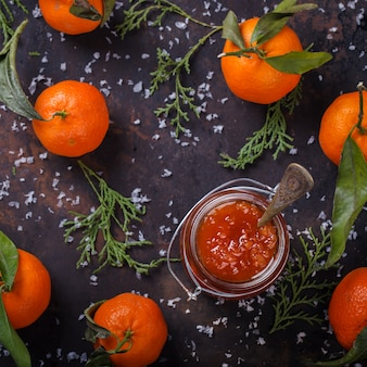 Tangerine jam in a glass jar. traditional dessert at christmas