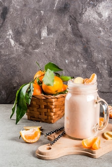 Tangerine smoothie with ginger in jar