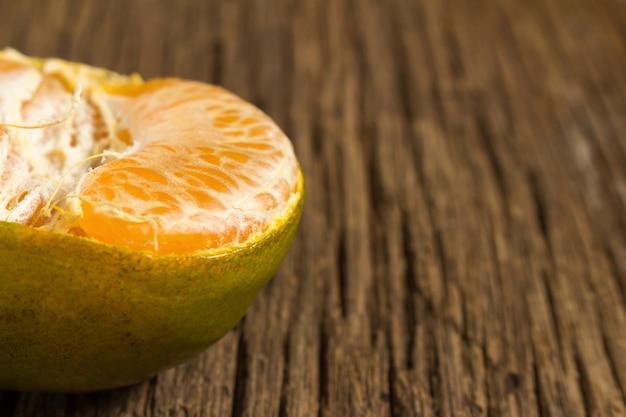 Tangerine. sweet orange. on wooden. texture wooden