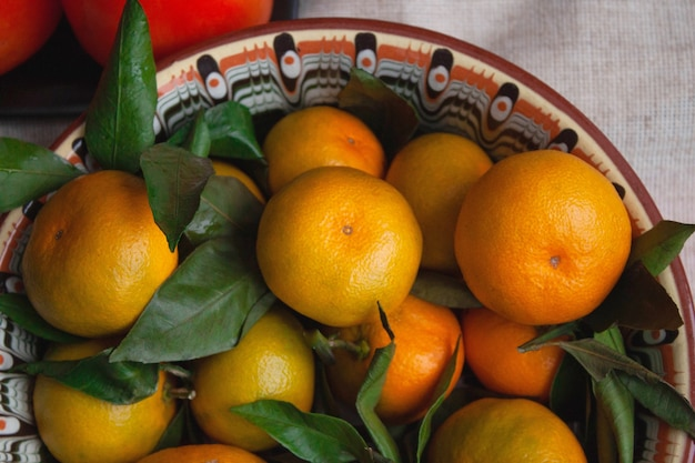 Tangerines are lying on a beautiful dish close-up. Premium Photo