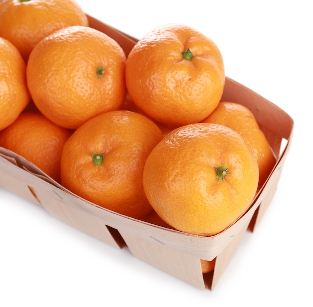 Tangerines in basket isolated on white surface