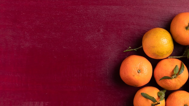 Tangerines for chinese new year with red background