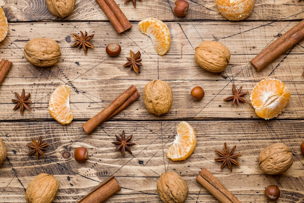 Tangerines and cinnamon sticks with anise and nuts